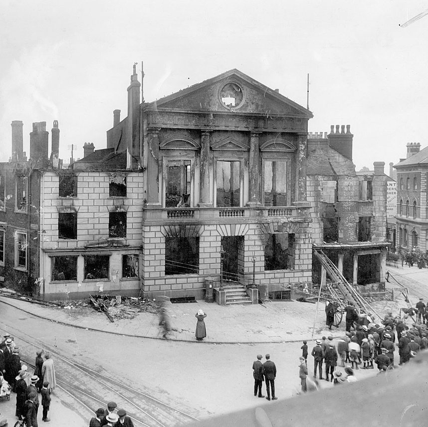 A photograph of Luton Town Hall after the Peace Day riots.
