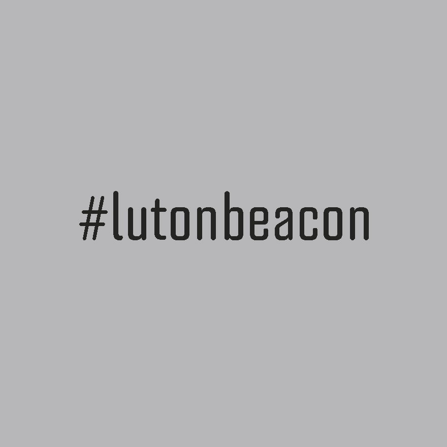 Black text on light grey background, reading #lutonbeacon.